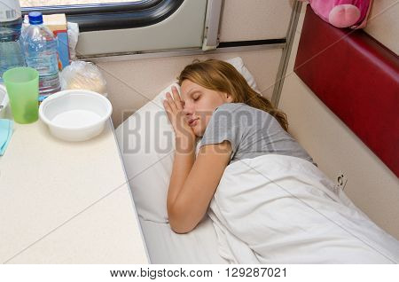 The Girl On The Train Is Fast Asleep At A Lower Second-class Place Car Coupe