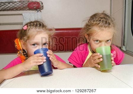 Two Children Drink Tea In Train At The Table On The Lower Place In The Second-class Compartment Wago