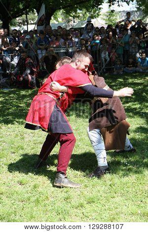 Belgrade, Serbia - April, 23, 2016: Men demonstrate medieval wrestling fighting at Belgrade Knight Fest
