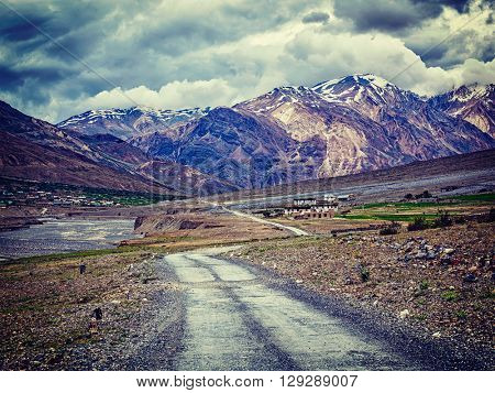 Vintage retro effect filtered hipster style image of road in Himalayas, Spiti valley, Himachal Pradesh, India
