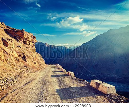 Vintage retro effect filtered hipster style image of road in Himalayas. Spiti Valley, Himachal Pradesh, India