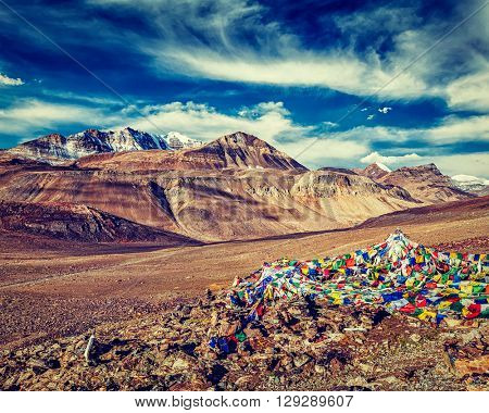 Vintage retro effect filtered hipster style image of Buddhist prayer flags (lungta) on top of Baralacha La pass on Manali-Leh road. Baralacha La Pass, Himachal Pradesh, India
