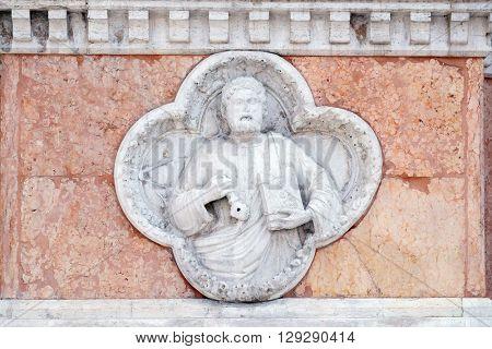BOLOGNA, ITALY - JUNE 04: Saint Peter by Giovanni di Riguzzo relief on facade of the San Petronio Basilica in Bologna, Italy, on June 04, 2015