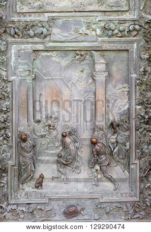 PISA, ITALY - JUNE 06, 2015: PISA, ITALY - JUNE 06, 2015: Adoration of the Magi, detail of the bronze door to the left of the Cathedral St. Mary of the Assumption in Pisa, Italy on June 06, 2015