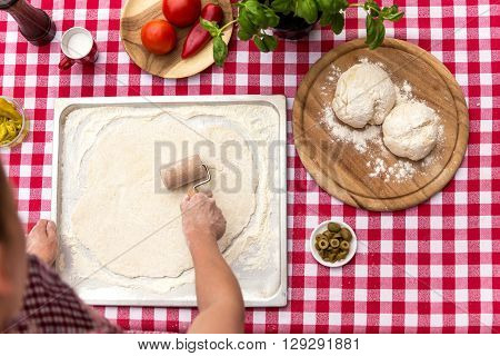 Woman Is Rolling Out Dough