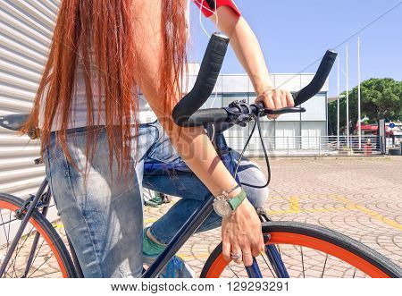 Young woman hands on bike handlebar ready for a cycling day - Healthy girl with sport bicycle going to work in a sunny summer day - Concept of green alternative transportation and active lifestyle