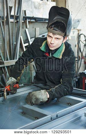 industrial arc welding worker