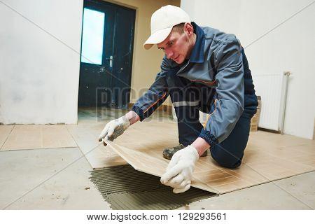 tiler at indoor floor tiling renovation