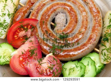 grilled sausages with vegetables and dill close-up. horizontal photo.