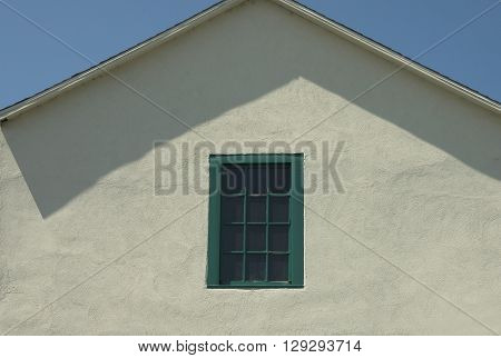a picture of an exterior 1850's adobe building