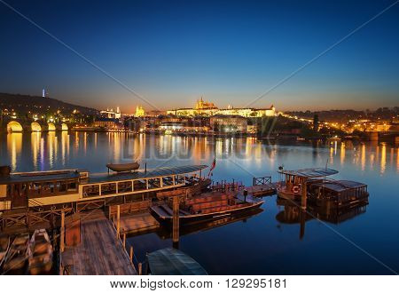 Boat dock during sunset near St. Vitus cathedral Prague Czech republic.