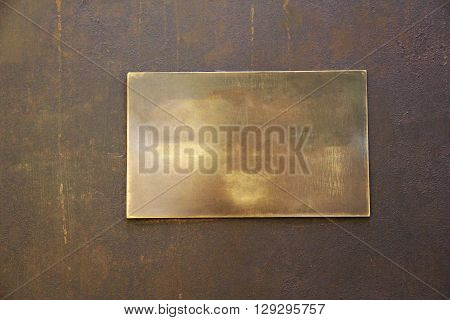 rectangular empty gloomy and with spots metal plate on a iron background