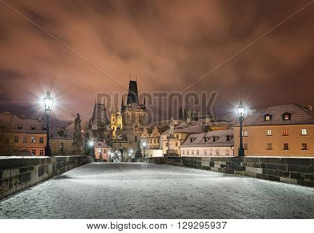 Lesser town winter night near Charles bridge Prague Czech republic