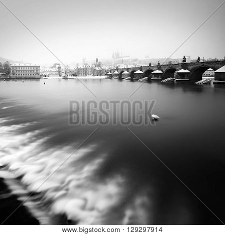 Charles bridge and St. Vitus cathedral during winter time Prague Czech republic