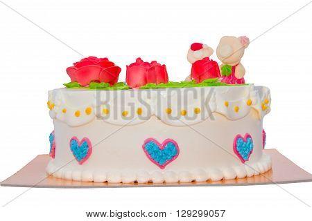 Cream cake with rose isolated on white background