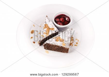 slice of delicious chocolate cake with berry jam isolated on white