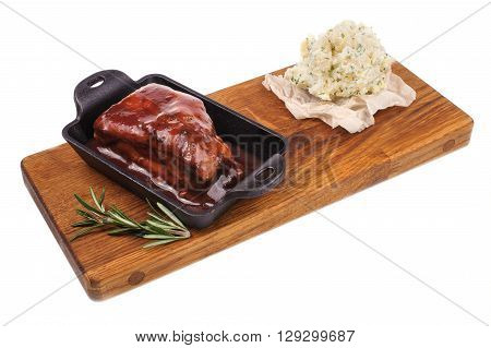 barbecued pork spare ribs on wood boad isolated on white
