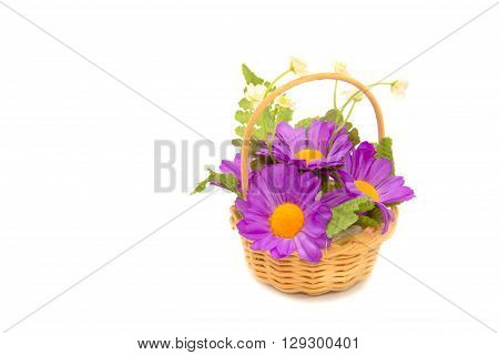 Basketry with Artificial chrysanthemum flower on white background