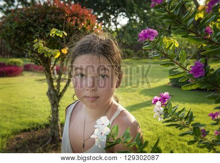 10-11 year old girl in a flowering garden