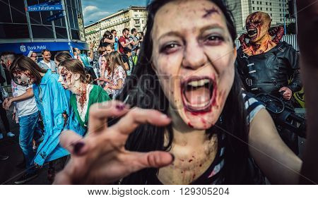 WARSAW, POLAND - JUNE 27 2015: Participants of the 9th Zombie Walk walks on street in Warsaw city center
