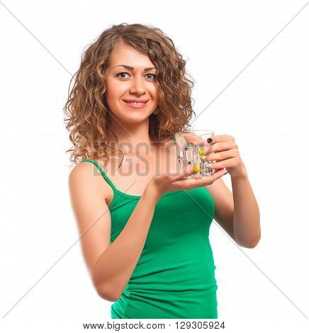 Smilling young woman with glass of water studio shot isolated