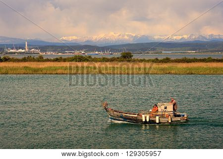 GRADO ITALY - APRIL 25: Old fisher boat in the Nature reserve of the Isonzo river mouth on April 25 2016