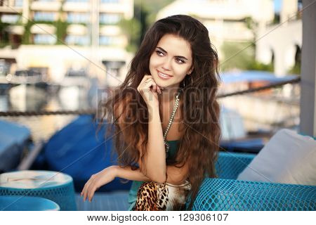 Portrait Of Happy Smiling Brunette Woman With Long Wavy Hair Thinking And Looking Away On Vacation W