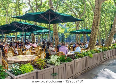 NEW YORK-JUNE 9: Outdoor dining in Bryant Park on June 9 2015 in New York City.