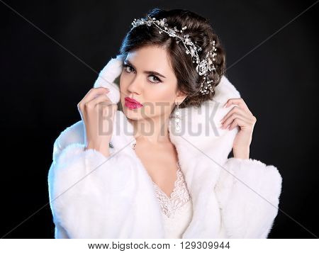 Fashion Portrait Of Beautiful Woman In White Fur Coat With Expensive Jewelry, Makeup And Wedding Hai