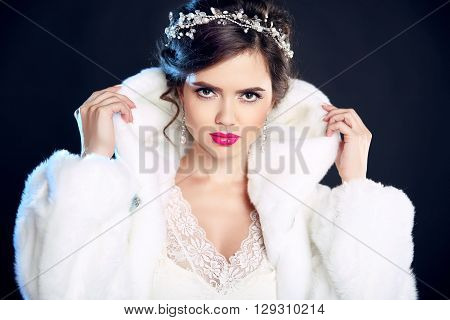 Winter Beauty Elegant Woman In White Fur Coat. Fashion Model Portrait Isolated On Dark Background. J
