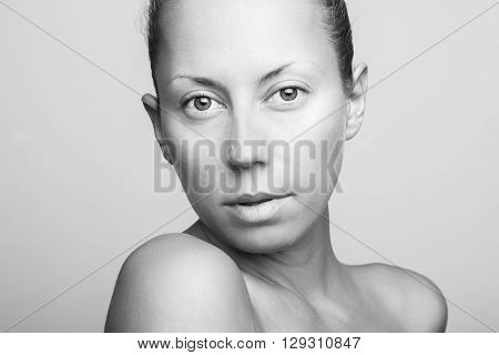 Portrait of beautiful young woman looking at camera.