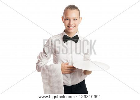 Portrait of young blonde waitress smiling at camera while holding tray and towel.Isolated.