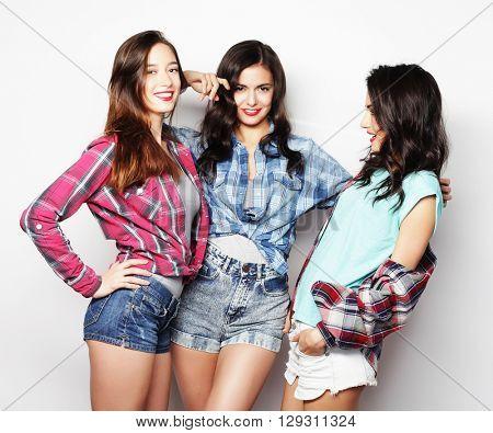 Three Girls smiling and having fun.