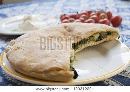 focaccia bread with filling of stir-fried escarole and dry fuit