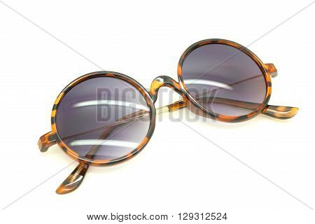 Isolated Sun glasses on a white background .