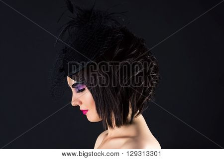 beautiful woman with dark makeup, profile face with veil