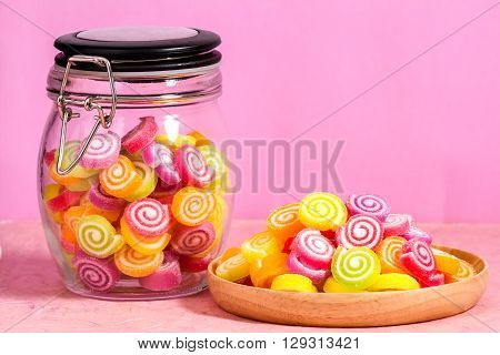 Colorful Candy And Jelly In Wooden Dish On Pink Background
