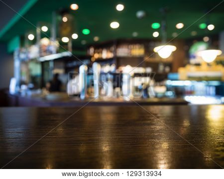 Table top Counter with Blurred Bar Restaurant Interior Background