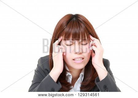 portrait of young Japanese businesswoman suffers from headache