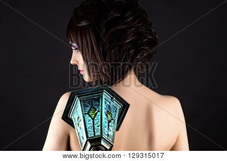 woman with beautiful hair with a blue lantern