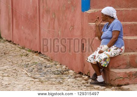 TRINIDAD, CUBA - FEBRUARY 2: cigar on February 2, 2007 in Trinidad: Cuban woman smoking cigar.