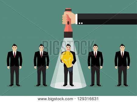 Hand holding flashlight glow to worker who has idea from group of businessmen. Recruitment concept