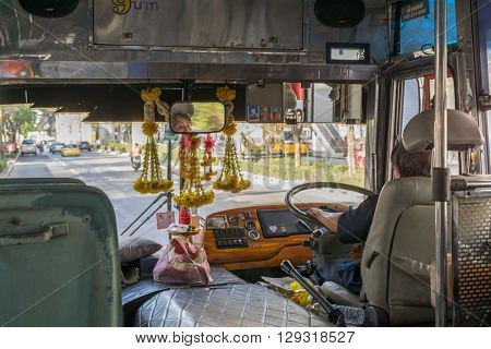 Bangkok Thailand - March 15 2016 : Unidentified bus driver drives bus in Bangkok. Buses are one of the most important public transport system in Bangkok.