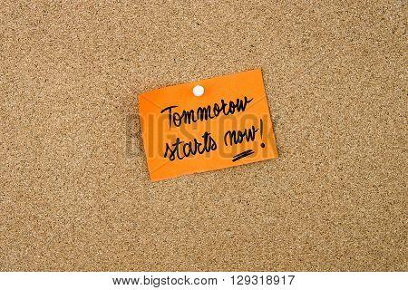 Tomorrow Starts Now Written On Orange Paper Note