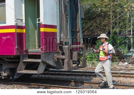 Bangkok Thailand - April 12 2016 : Unidentified railway employees controlling the locomotive for switching the railway before serving at State Railway of Thailand.