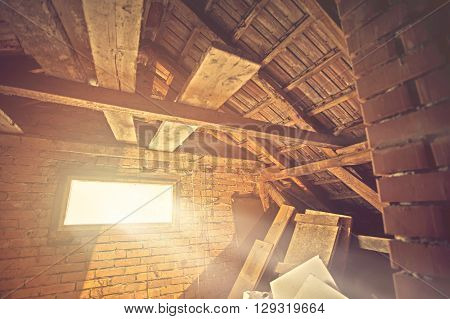 Attic window with sunrays through the window