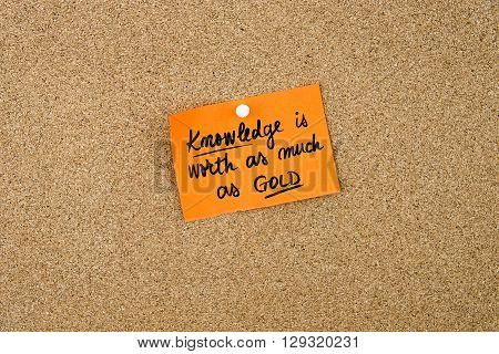 Knowledge Is Worth As Much As Gold Written On Orange Paper Note