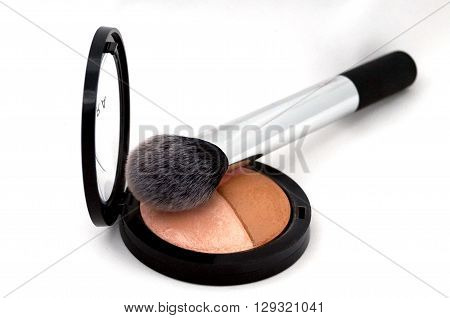 multicolor blush and cosmetic brush on white