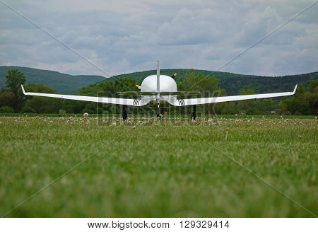 small sport aircraft at the airport, view from behind