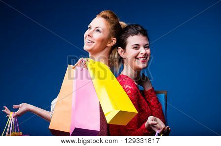 Women Shopping With Lots Of Bags On Blue
